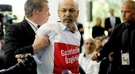 Αντιμέτωπος με το ενδεχόμενο απέλασης ο δημοσιογράφος που διαμαρτυρήθηκε κατά τη διάρκεια της επίσκεψης Ερντογάν