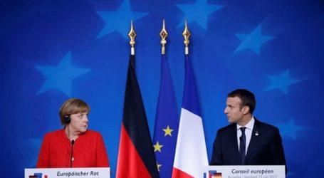 The Times: Σύγκρουση Μέρκελ – Μακρόν για τον επικεφαλής της Ευρωπαϊκής Επιτροπής