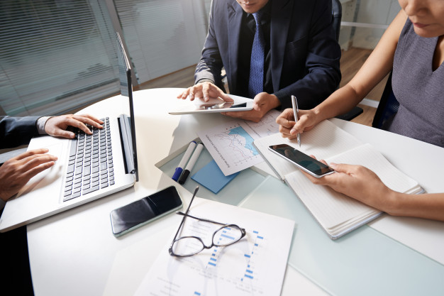 business people sitting office desk working project 1098 17930