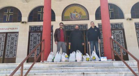 Προσφορά τροφίμων για απόρους της ενορίας του Ι.Ν. Αγίου Αθανασίου Λάρισας από τη Διεθνή Ένωση Αστυνομνικών