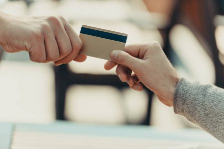 depositphotos 165392886 stock photo woman giving credit card to