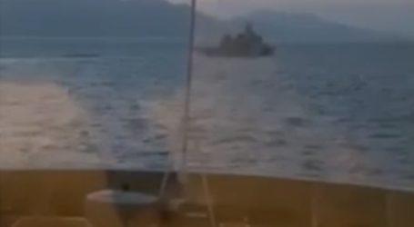 Τουρκική ακταιωρός περνάει δίπλα από επιβατηγό πλοίο ανοιχτά της Ρόδου