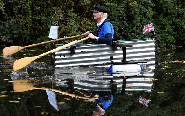 80 year old military veteran stanley rows homemade boat named the tintanic to raise funds for charity st wilfrids hospice in chichester