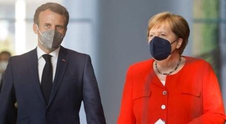 Αυστηρότερο πλαίσιο για τους ταξιδιώτες εκτός ΕΕ ζητούν Μέρκελ-Μακρόν