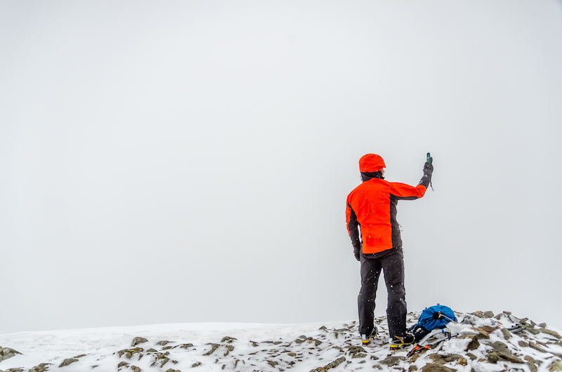 Zac Poulton one of the Lake District National Park s fell top assessors taking weather observations on Helvellyn. Picture credit to Adam Simpson and Mountain Hardwear 6